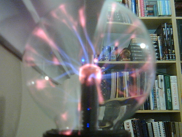 Webcam view of a plasma globe in operation.